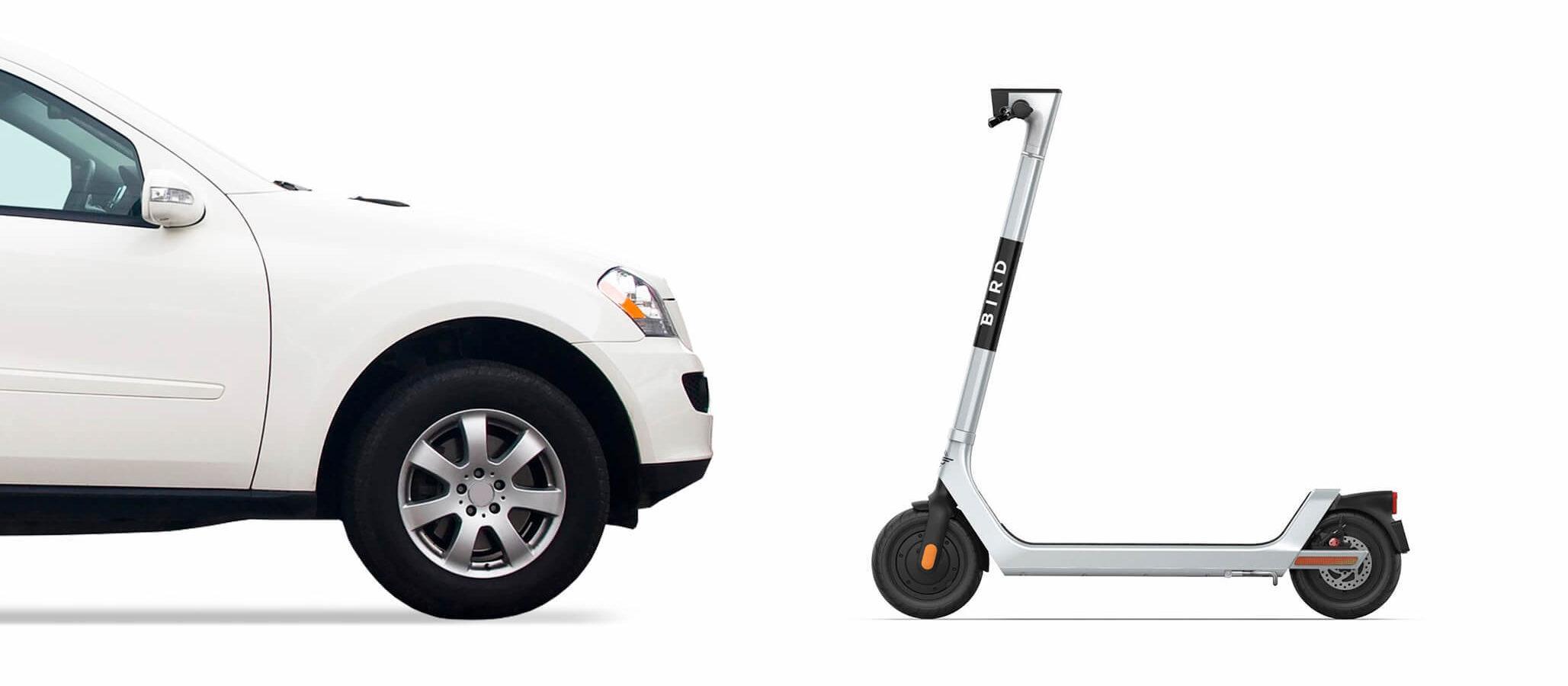 Car facing off with a Bird scooter